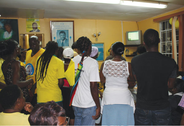 Watching the count in the office of Stephenson King the winner in Castries North. [PHOTO By Photo Mike]