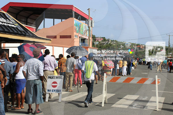 img This was the scene outside the Phillip Marcellin Grounds Tuesday afternoon for the swearing in of the Cabinet of Ministers. The event was open to the public however, those without a special invitation, had to form a line for orderly entry into the mini-stadium. (Photo by Photo Mike)