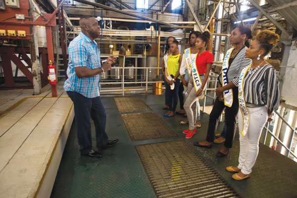img: St-Lucia Distillers Ezra James on tour with the Carnival queen contestants