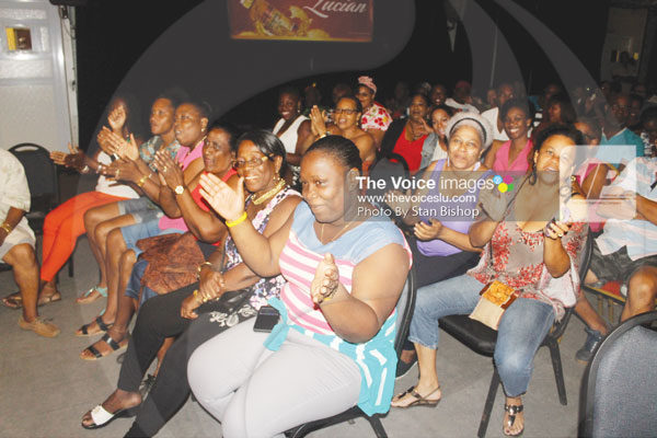 img:Calypso fans enjoying themselves at a tent. [PHOTO: Stan Bishop]