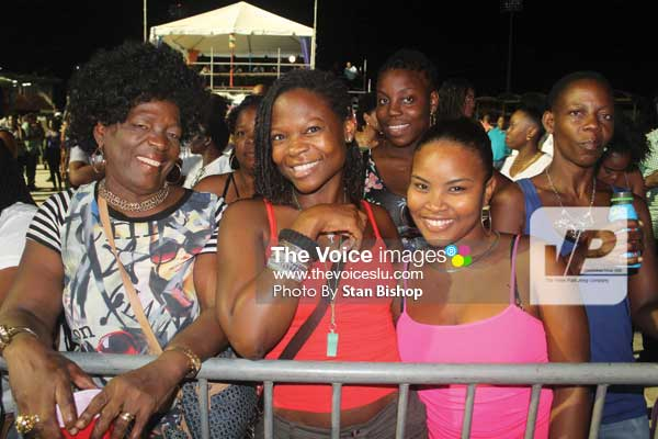 """Image: These patrons were all smiles after Menell's spellbinding performance of """"Rivers of Blood"""" at the Calypso Monarch. [PHOTO: Stan Bishop]"""