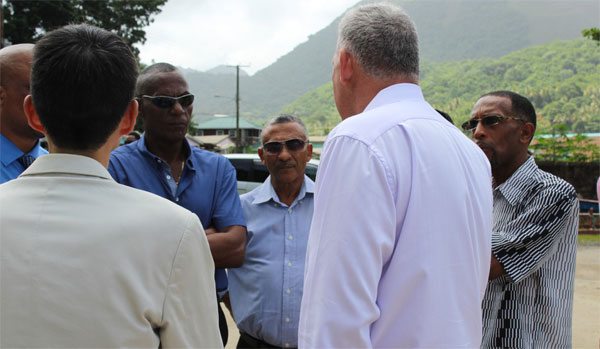 Image: Chastanet (R) and Taiwanese Ambassador, Ray Mou (back to camera) in conversation with some members of the Board of the Directors of the Soufriere Development Foundation near Hummingbird Beach Thursday.