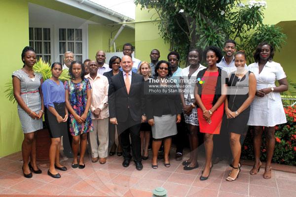 img: Ambassador Soberon, Permanent Secretary Brathwaite, Humanistic Solidarity Association members and the students at Thursday's presentation ceremony. [PHOTO: Stan Bishop]