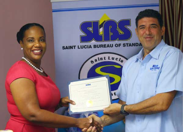 Image: Dr. Walcott presents the SLBC standard to Blue Waters