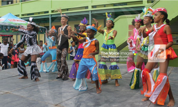 "img:Young revellers bounce to Ezra's catchy groovy soca, ""Swim My Way"". [PHOTO: Stan Bishop}"