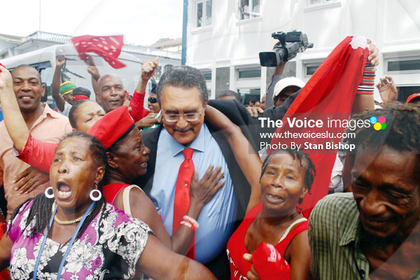 Image: Former Prime Minister Dr. Kenny Anthony was thronged by supporters as he made his way into Parliament. [PHOTO: Stan Bishop]