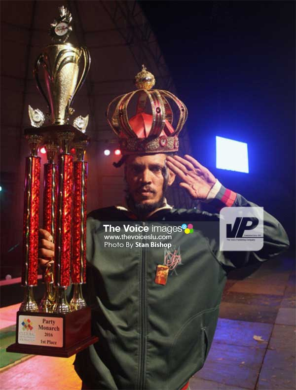 Image: Islah Man with his crown and trophy.  [PHOTO: Stan Bishop]