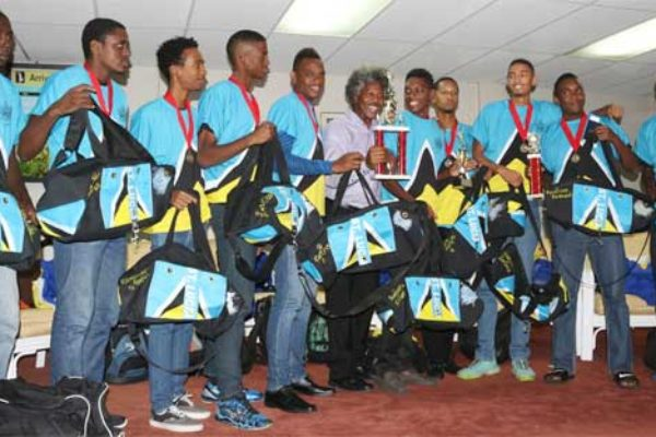 Image: Picture moment for Team St. Lucia and PS Youth Development and Sports Dr. Anthony George at the George F.L. Charles Airport VIP Lounge..