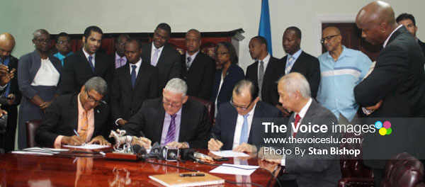 Image: Prime Minister Allen Chastanet, DSH Chairman Teo Ah Khing and Minister Bradley Felix signing the agreement yesterday.[PHOTO: Stan Bishop]