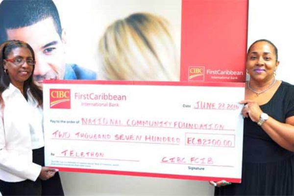Image: Soraya Warner-Gustave presents cheque to NCF's Michelle Phillips.
