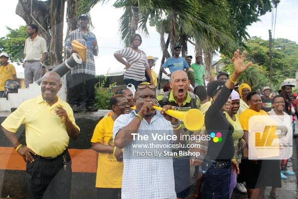 Image: UWP supporters heralding the arrival of Castries South-East MP, Guy Joseph. [PHOTO: Stan Bishop]