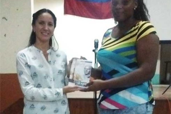 Image: Venezuelan Ambassador presents copies of the book on Bideau to one his descendants