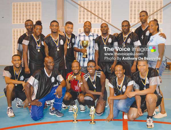 Image: A photo moment for the 2016 champions along with Acting Police Commissioner Severin Moncherry holding Championship trophy (Photo: Anthony De Beauville)