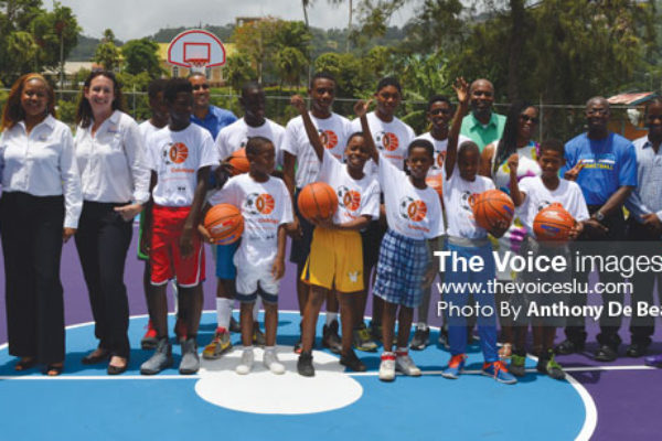 """Image: A photo moment for Sandals Doundation, Dwayne Wade Foundation, Kenneth """"Wriggler"""" King committee, BFTF young and aspiring players Photo Anthony De Beauville)"""