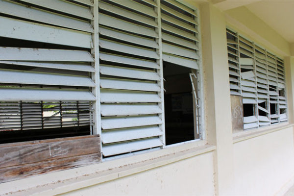 Image: section of the Soufriere Comprehensive Secondary School with broken windows.