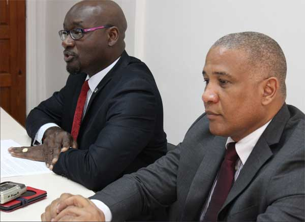 Image: Moses Jn Baptiste and Ernest Hilaire at the press conference.