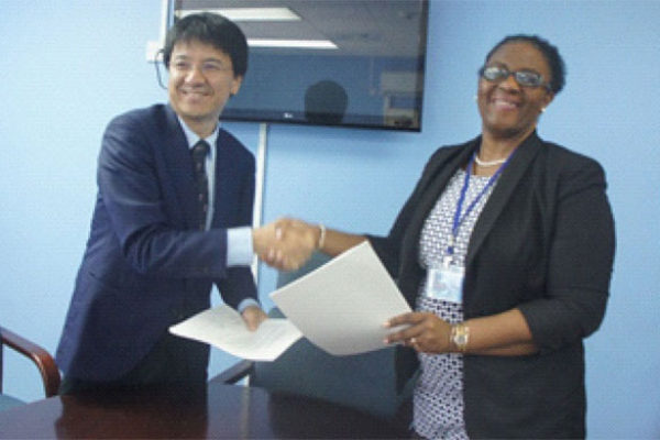 Image: Mrs. Allison A.Jean, Permanent Secretary, Ministry of Infrastructure and Mr.Sakabe, leader of the preparatory survey team of JICA following the signing of the Minutes of Discussions.