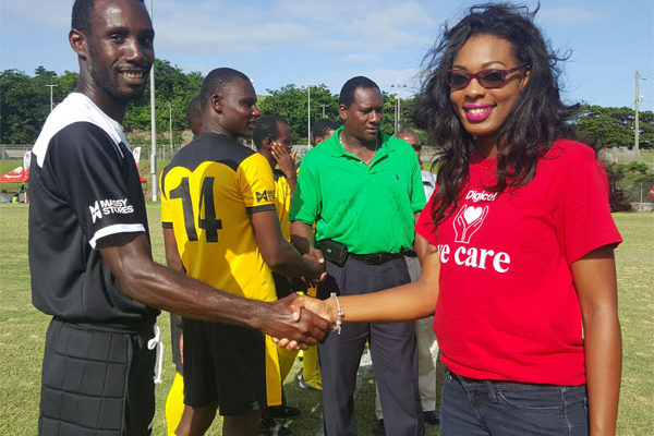 Image: Ms. Victor and Northern U Captain Giovanni Deterville shake hands