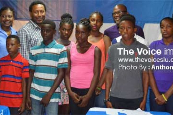 Image: A photo moment for the students who received scholarships alongside SLFA President Lyndon Cooper, SLFA Vice President Emmanuel Belasse, Vizions Entertainment, Edward Fedee, Grace Representatives, Youth and Sports Officer Ligorious Marquis. (PHOTO: Anthony De Beaville)