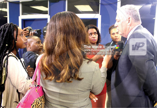 img: The media quizzing Prime Minister Allen Chastanet following Monday evening's press conference. [PHOTO: Stan Bishop]