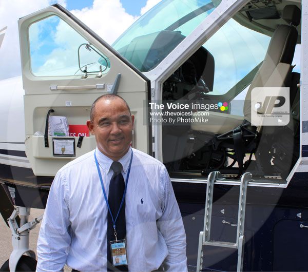img: REYES standing outside his 12-seater at Vigie.