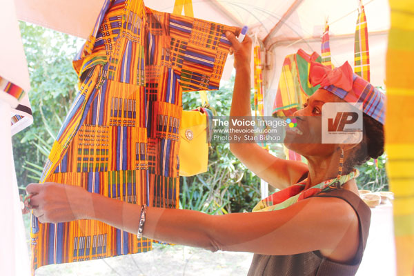 img: This craftswoman puts on a great showing with her madras outfits. [PHOTO: Stan Bishop]