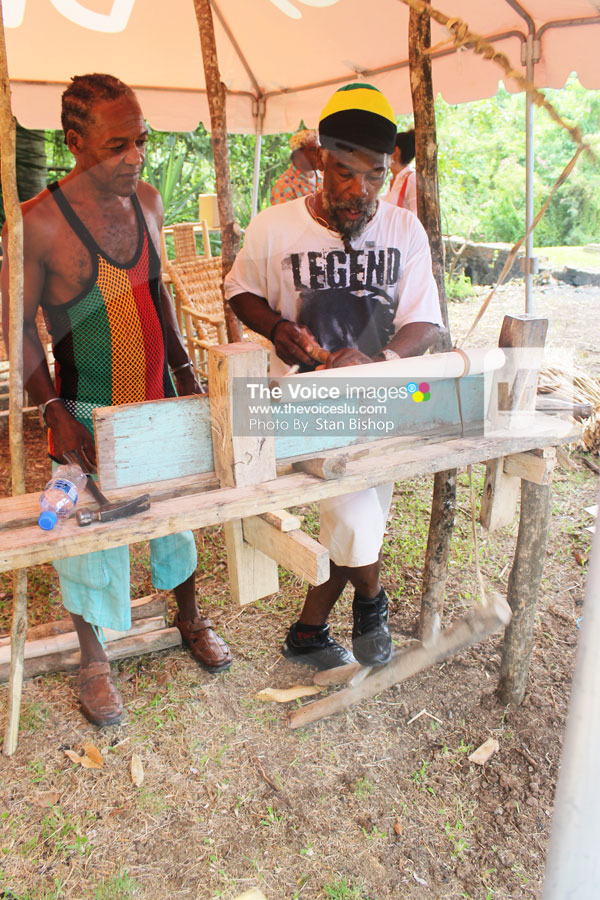 img: These craftsmen from Mongouge, Choiseul demonstrate how they transform locally-grown wood into exquisite furniture using a traditional lathe. [PHOTO: Stan Bishop]