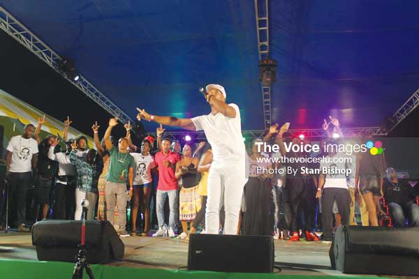 """Image: Groovy soca monarch, Arthur, leads the star-studded cast in a performance of """"Unconditional Love"""". (PHOTO: Stan Bishop)"""