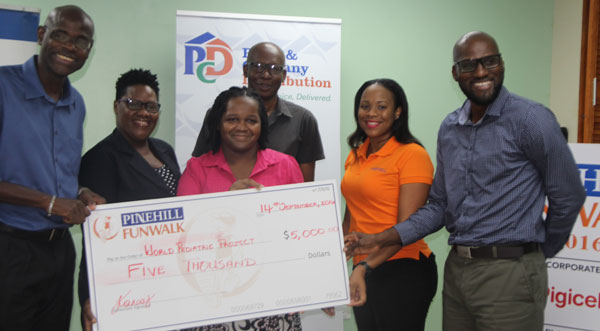 img: Representatives of Peter & Company Distribution and The World Pediatric Project at check presentation.