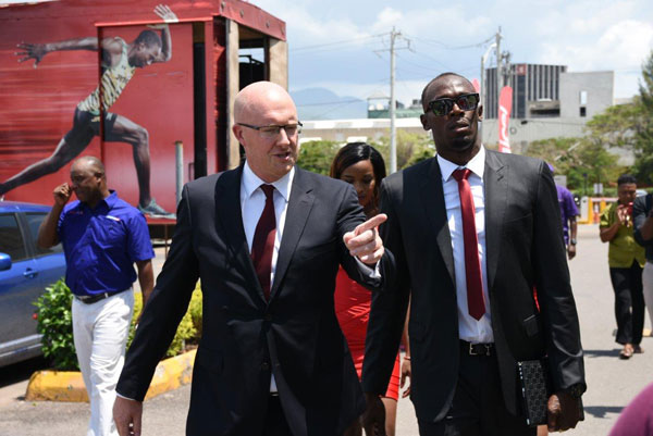 img: David Butler, Digicel Jamaica CEO, welcomes Usain Bolt, Digicel CSO, to work on his first day.
