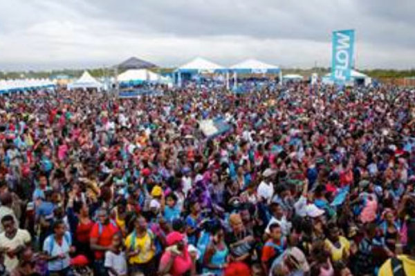 img: A section of the large crowd, which gathered at the JamWorld Entertainment Centre for the seventh staging of FLOW Skool Aid 2016.