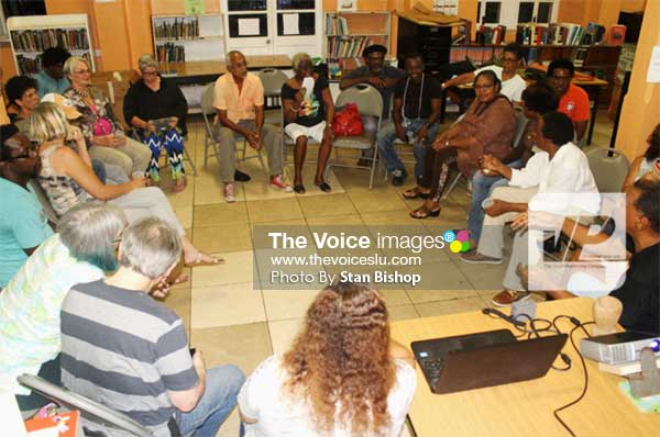 Image: The Artist Circle discussing ways to revolutionize art appreciation in Saint Lucia. [PHOTO: Stan Bishop]