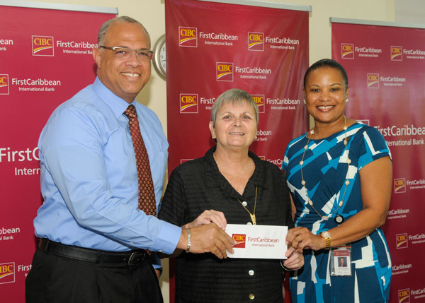IMG: Mark St. Hill (left) and Donna Wellington (right) present the cheque to Jenny Tryhane (centre).