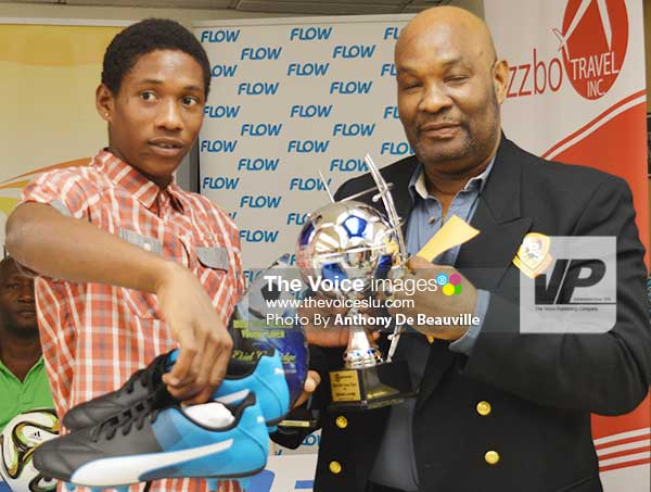 Image: (left) Elite Youth Player EkielGreenidge of Marchand receiving his award from one of the sponsors. (Photo: Anthony De Beauville)