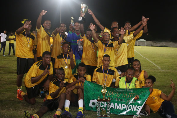 img: Members of the unbeatable C Bay Hard Nuts football team celebrating their victory following the final.