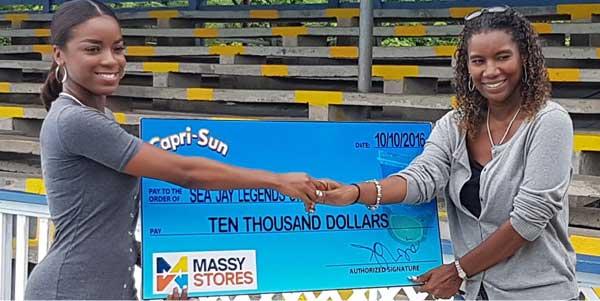 (L-R) Massy Stores representative presenting Sea Jays Sue Monplaisir with  sponsorship cheque  (PHOTO: SJSC)