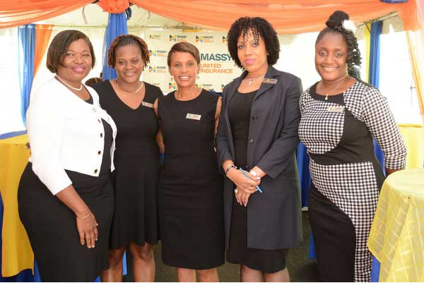 Image: Massy staffers at the Soufriere opening