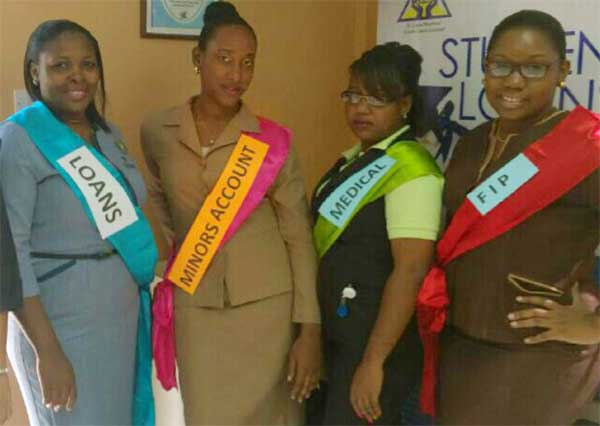 Image: Staff members exhibit a few of the products offered at St. Lucia Workers Credit Union.