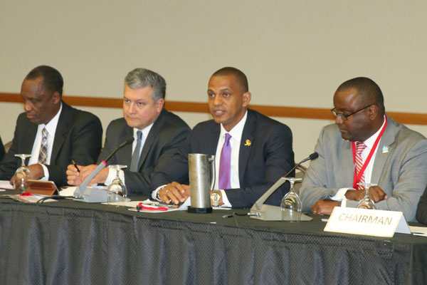 img: Daniel Best (2nd right), Director of Projects at the CDB, addresses the High Level Forum. Also in the photo are Brigadier General Ancil Wayne Antoine, Minister of Public Utilities, Trinidad and Tobago (left), Sergio Campos, Division Chief, Water and Sanitation, Inter-American Development Bank (2nd left) and Jason Johnson, President, CWWA.