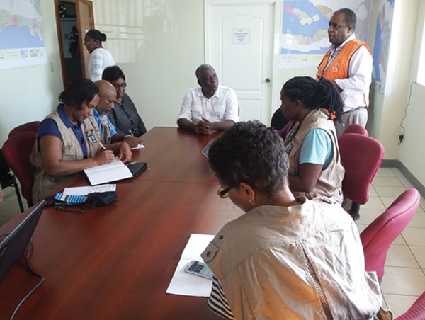 img: Members of the COST meeting with Minister Francois Anick Joseph and Madame Jean Baptiste, Director of the CPD.