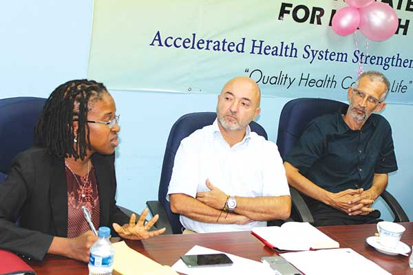 Image: EU Officals in discussion with local health personnel