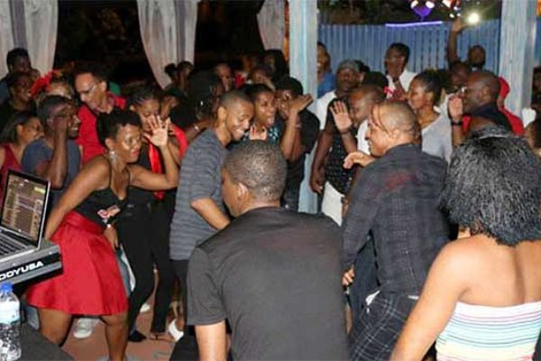 Image: Fun-loving Salsa dancers on the floor.
