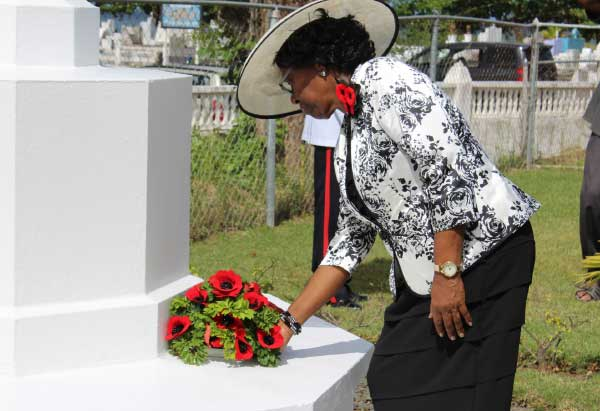 Image: Governor General Dame PearletteLouisy laying a wreath at the War Grave at Choc Cemetery.