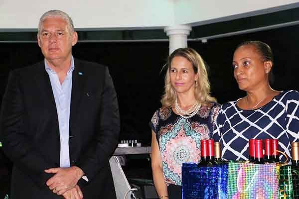 Image: Prime Minister Chastanet about to hand out special tokens.