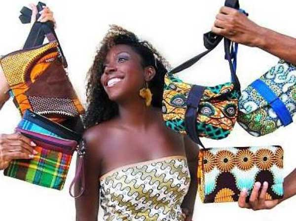 Image: Taribba showing off some of her bags