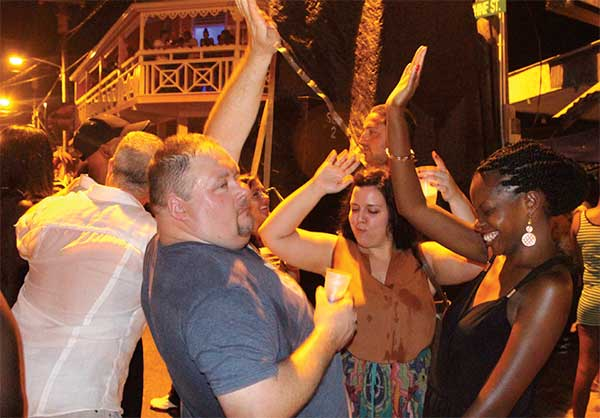 Image: Tourists having fun at Gros Islet.