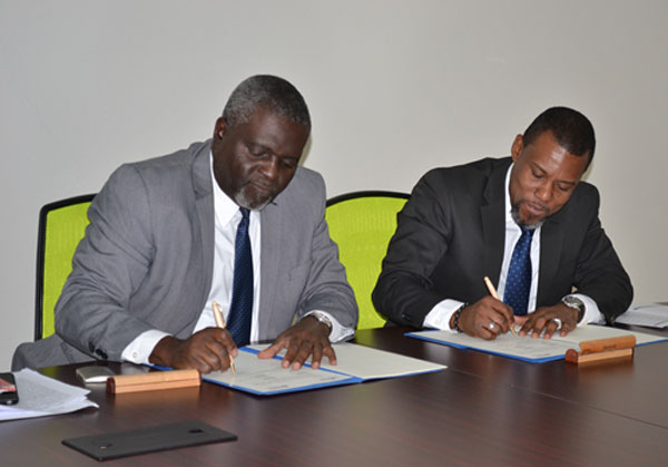 img: Executive Director of CARICAD Devon Rowe (left) and Executive Director of CDEMA, Ronald Jackson signed MOU signaling a strategic partnership between the two institutions.