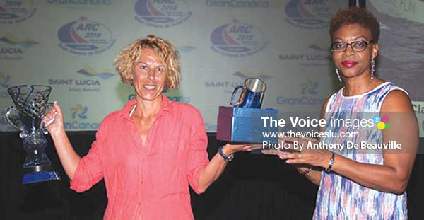 Image: Saint Lucia Tourist Board Executive Director Agnes Francis presents the IB award to a crew member of More Fun. (Photo: Anthony De Beauville)