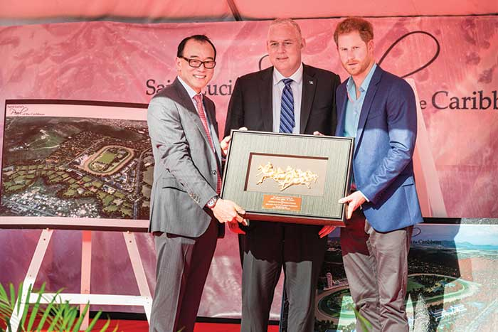 Image: From left: Chairman of DSH Caribbean Star Ltd and China Horse Club, Mr. Teo Ah Khing and Saint Lucia's Prime Minister Allen  Chastanet make a  presentation to  Prince Harry