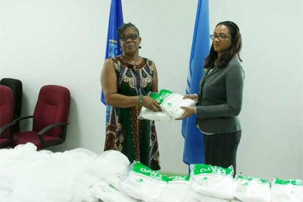 Image: Dr. Belmar George (right) receives the donation.